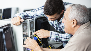 Computer Technician Helping Senior